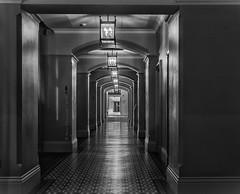 Vacant Virtue (devil=inside) Tags: handphotography sony a77 tamron hotel london bw monochrome st pancras lights arches pillars corridor passage architecture structure