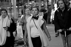 People on Market St 117 (TheseusPhoto) Tags: candid candids california sanfrancisco blancoynegro blackandwhite bnw monochrome monotone people streetphotography street woman girl strap face scarf