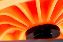 orange radiation (HansHolt) Tags: wheelbarrow wheel barrow centre axle centrum radiation radiating rays stralen plastic orange oranje garden tuin abstract macro dof canon 6d 100mm canoneos6d canonef100mmf28macrousm macromondays transportation hmm