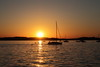 Sailboat crossing the sunset (danielhast) Tags: madison wisconsin sunset lakemendota mendota lake water sky sun people sailboat boat