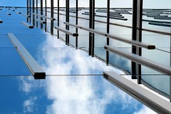 Flying Beams (2n2907) Tags: onblue reflection glass building abstract canon t4i digital dslr sky clouds