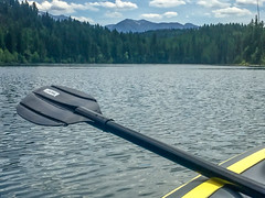 Oar You With Me? (oliemackeral) Tags: lake mountains kayak oar water trees nature boat ripples clouds yellow blue black paddle peaceful birthday