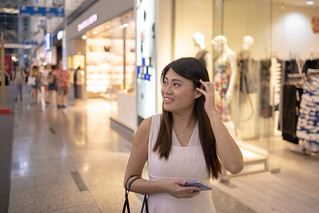 Woman shopping in mall  in Singapore