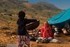 Kalbelya music camp.  Pushkar Mela. Rajasthan (Tito Dalmau) Tags: kalbelya music camp woman children fair mela camels