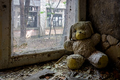 Radioactive Teddy (Frank C. Grace (Trig Photography)) Tags: prypyat kyivskaoblast ukraine ua teddybear toy stuffedanimal hospital chernobyl pripyat abandoned urbex disaster fallout nuclear powerplant power urbanexploration russia ghosttown haunted paranormalactivity decay rusty crusty nuclearreactor reactor radiation exclusionzone forbidden zone nuclearcity powerstation ukrainebelarusborder sovietunion boarder при́пять peacefulatom ukrainebelarus hdr highdynamicrange on1pics frankcgrace trigphotography 1986