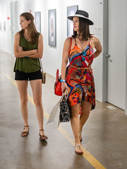 Two Girls, Art Exhibit (Ron Scubadiver's Wild Life) Tags: street people portrait nikon 50mm houston texas style shorts sandals print hat sawyer yards