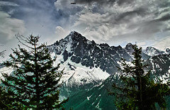 From Plan Praz (Fr Paul Hackett) Tags: mountain snow conifers sky clouds
