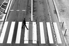 On the white bands (pascalcolin1) Tags: paris13 homme man passagepiéton crossroads crossing blanc white photoderue streetview urbanarte noiretblanc blackandwhite photopascalcolin 50mm canon50mm canon