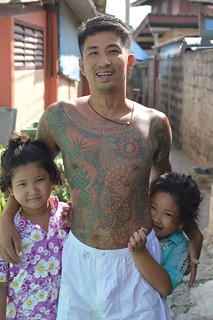 tatttooed father with twin daughters