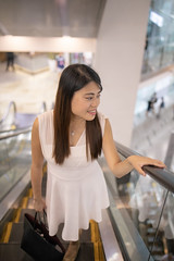 Happy shopping! (Apricot Cafe) Tags: img94403 asia asianandindianethnicities chineseethnicity clarkequay healthylifestyle singapore tamronsp35mmf18divcusdmodelf012 carefree citylife colorimage consumerism escalator fulllength happiness indoors leisureactivity lifestyles longhair lookingaway moving movingup oneperson oneyoungwomanonly people photography realpeople shopping shoppingmall sleeveless smiling straighthair toothysmile weekendactivities whitedress women youngadult sg
