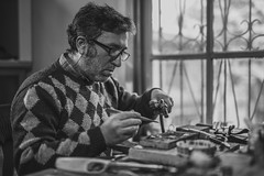 Grayscale Photo of Man Holding Tools - Credit to http://homedust.com/ (Homedust) Tags: adult artisan black andwhite blur concentration eyeglasses eyewear furniture indoors industry jewelry job man monochrome old person portrait repair room tools wear window working workplace workshop