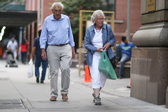 A couple on 49th Street between 8th and 9th Avenues. (kevinrubin) Tags: newyorkcity street streetphotography nyc newyork unitedstates us