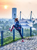 Preparing for the off in the shadow of the 1972 Olympic Stadium in Munich (Andy J Newman) Tags: olympus deutschland color stretch sunsets germany young lady dusk girl colour run backdrop sundaisles woman colorefex runner park athletes om munich olympic münchen bayern de