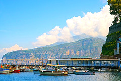 At the Port Under Storybook Clouds (Herculeus.) Tags: 2018 compania europe may sorrento italy port boats hills mountains clouds rock wharf landscape landscapes outside outdoor outdoors people buildings 5photosaday