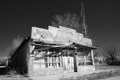 groceries (Tomás Harrison Fotografía) Tags: ghosttown abandoned nikon tree torrancecounty blackandwhite encino d750 ushwy285 availablelight afnikkor24mmf28d ngc nm dying usa