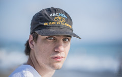 Sam Laguna Beach (lgflickr1) Tags: portrait people hat beach lagunabeach stare california coast westcoast d750 exterior teenager teen water ocean outdoor outside oceanfront blue abc oj zeiss 85mm nikon milvus summer eyecontact ojsimpson abcnews stubble dof f14 shallow seaside southerncalifornia serious thelook gaze baseballcap prime