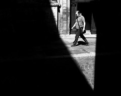 Triangular Shadow 3 (Mattiii photo) Tags: street streetphotography streetphoto streetshot streetphotographer streets streetitalia streetph streetshots streetphotograph streetlife streetparma strada streetimage streetminimal streephotographer streethsot urban urbanphotography urbanphoto urbanshot shadow shadows triangular triangularshadows triagle one person shadowshunter geometry line lines blackandwhite blackandwhitephotography blackandwhitephoto biancoenero blackandwhiteshot blackandwhitephotographer blackwhite bnw bnwphoto bnwphotography bnwshot great lovely walking walker italia italy italianstreetphotography italianstreetphotographer italian
