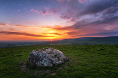 Erratic sunset (Pete Rowbottom, Wigan, UK) Tags: ingleton northyorkshire yorkshiredales yorkshirelandscape erraitic sunset dusk colourful highviewpoint clouds nikond750 nikon1424f28 peterowbottom uk greatbritain england glacialerratic rock stone hills sunlight light red yellow art pink purple boulder outdoors geotagged rural remote cravendistrict glow nature weather warmth landschaft moon