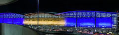 sfo illuminates in blue and gold supporting the warriors in game 2 of the 2018 nba finals (pbo31) Tags: bayarea california night black color nikon d810 boury pbo31 urban city june 2018 contemporary architecture sanfranciscointernational sfo millbrae sanmateocounty aviation airport plane airline terminal over lightstream motion traffic roadway warriors goldenstate nba blue finals gold basketball championship illuminated panoramic large stitched panorama
