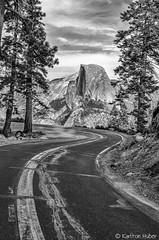 Yosemite - Glacier Point Road (www.karltonhuberphotography.com) Tags: 2013 california curve dome doubleyellowline forest glacierpointroad granite granitewall halfdome iconic karltonhuber landscape leadinglines monolith mountain mountainroad mountaintop naturalframe nikond7000 pinetrees road texture trees verticalimage view yosemite yosemitenationalpark