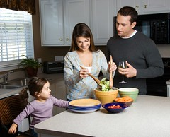 Stock Images (perfectionistreviews) Tags: horizontal indoors color photograph threepeople caucasian 3035years midadult 12years toddler female girl children child mixing preparing prepare dinner meal food nutrition salad counter kitchen home male men man carrot tomato lettuce healthy smile smiling happy parenthood parent dad father daughter mom mother close togetherness family sharing wife husband vegetable domesticscene childhood kids youth relationship people cooking lifestyle woman foodanddrink