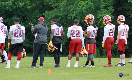 Redskins offensive players look on during practice.