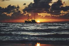 SPO (digital_underground) Tags: ship sunset sun water sea meer beach wave clouds