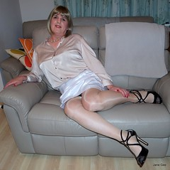 Tucked (janegeetgirl2) Tags: transvestite crossdresser crossdressing tgirl tv ts stockings heels garters nylons glamour lingerie white satin skirt blouse stilettos fully fashioned highheels bra mini rht short