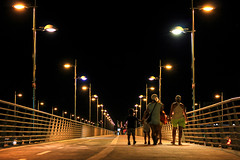 Summer night (Daniel Nebreda Lucea) Tags: night noche city ciudad family familia walking andando bridge puente path camino paso summer verano light street calle urban urbano happy feliz life vida travel viajar composition composicion shadows sombras dark oscuro black negro yellow amarillo perspective perspectiva zaragoza aragon spain españa canon 50mm 60d people architecture arquitectura building structure estructura construccion texture textura luz modern moderno new nuevo hot calor lifestyle estilo long exposure larga exposicion pathway pasarela nights noches