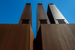 Three rusty chimneys (Maerten Prins) Tags: netherlands nederland utrecht uithof campus universiteit university modern brown rust rusty stadsverwarming blue sky