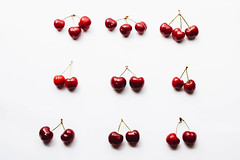 Top view of cherries on white background (wuestenigel) Tags: wood lay natural berries sweet leaf table space background healthy above delicious cherries overhead ripe fresh white raw flat pattern group berry red garden nature summer nutrition wooden cherry bright vegetarian top view food vitamin juicy fruit tasty organic