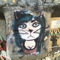 Cat 2 (evil robot 6) Tags: seattle postalley cat graffiti stickers streetart
