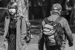 Coming and going (Frank Fullard) Tags: frankfullard fullard candid street portrait couple lady man gentleman dublin backpack monochrome blackandwhite coming going opposites irish ireland contrast
