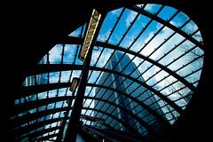 high rise (Jonathan Vowles) Tags: london canary tube underground window escalator grid