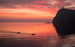 Paddling Home (manxmaid2000) Tags: sunset sea kayak sail paddle reflection canoe people isleofman manx iom porterin drama fiery red pink seaside coast water ocean cliff tower uk bay boat sailing coastal irishsea sky clouds cloudscape fuji