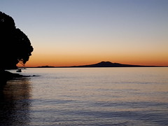 Iconic Rangitoto Island, Auckland, New Zealand (scinta1) Tags: newzealand aucklandnz auckland pohutukawacoast beachlands shellybay volcano rangitotoisland coast beach water harbour blue orange sunset ripples calm tree conical