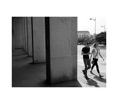 passers by (chrisinplymouth) Tags: pedestrian plymouth devon england uk white monochrome couple black grayscale cw69x xg wb