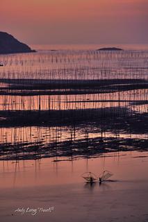 Fishing at the tidal flats