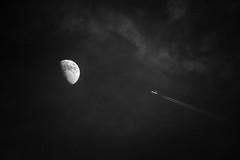 reaching the moon (Neko! Neko! Neko!) Tags: blackandwhite blackwhite bw mono monochrome sky night nightsky plane airplane flyby moon