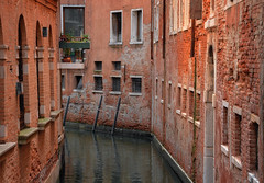 Narrow Canal Bend (henriksundholm.com) Tags: architecture buildings houses canal water ripples reflections bend corner narrow city urban poles balcony windows brick hdr venice veneto venezia italy