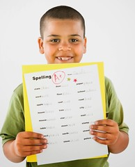 Stock Images (perfectionistreviews) Tags: child children youth people childhood person onepersononly indoors studio proud showing smile smiling portrait learning education grade smart homework studying school schoolwork standing hispanic latino happy vertical a boy