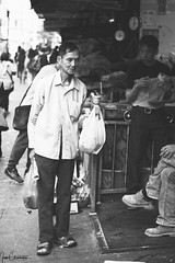 Marketplace Patron (iecharleton) Tags: streetphotography candid street person monochrome chinatown newyork manhattan