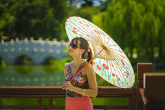 She Smiles (RobertCross1 (off and on)) Tags: a7rii alpha ca california chinesegarden emount fe85mmf18 huntingtonlibraryandgardens ilce7rm2 losangeles pasadena sanmarino socal sony southerncalifornia bridge fence fullframe girl mirrorless parasol portrait woman