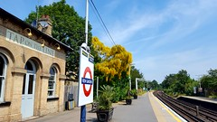 Kew Gardens Station. Greater London. UK (standhisround) Tags: kewgardens kew london station railway kewgardensstation platform building trees shrub sign sky track uk pub tapontheline overground tfl districtline