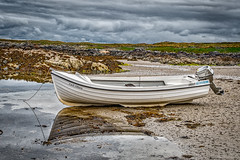 Beached (squirrel.boyd) Tags: boat ashore lowtide donegal rocks seaweed rockpools