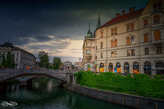 June 09, 2018.jpg (outlaw.photography) Tags: clouds architecture slovenia bridges outlawphotography infinityimages chrisdaugherty ljubljana photography city sky people europe062018 water canal light