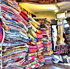 Colorful Turkish Rugs (Jill Rowland) Tags: colorful rugs store retail interior istanbul turkey canonphoto