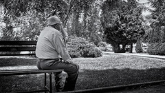 Memories (Alfred Grupstra) Tags: men outdoors people oneperson bench males blackandwhite caucasianethnicity adult sitting lifestyles parkmanmadespace youngadult loneliness hat nature tree casualclothing solitude summer