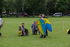 Historia Normannis Meadows June 2018-750 (Philip Gillespie) Tags: historia normannis central scotland sparring fighting shields swords axes spears park grass canon 5dsr men man women woman kids boys girls arms feet hands faces heads legs shins running outdoor tabards chain mail chainmail helmets hats glasses sun clouds sky teams solo dead act acting colour color blue green red yellow orange white black hair practice open tutorial defending attacking volunteer amateur kneeling fallen down jumping pretty athletic activity hit punch