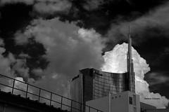 Milano nelle nuvole. (stefano.chiarato) Tags: milano lombardia italy torreunicredit nuvole clouds edificio building urban bw biancoenero pentax pentaxk70 pentaxart
